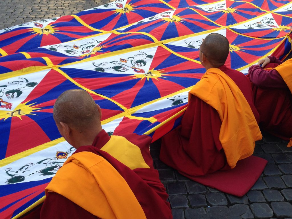 Tibetan Monks with flag, Lhasa, 48 hour is lhasa