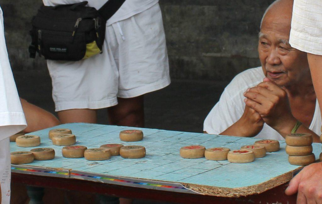 Locals playing Mahjong