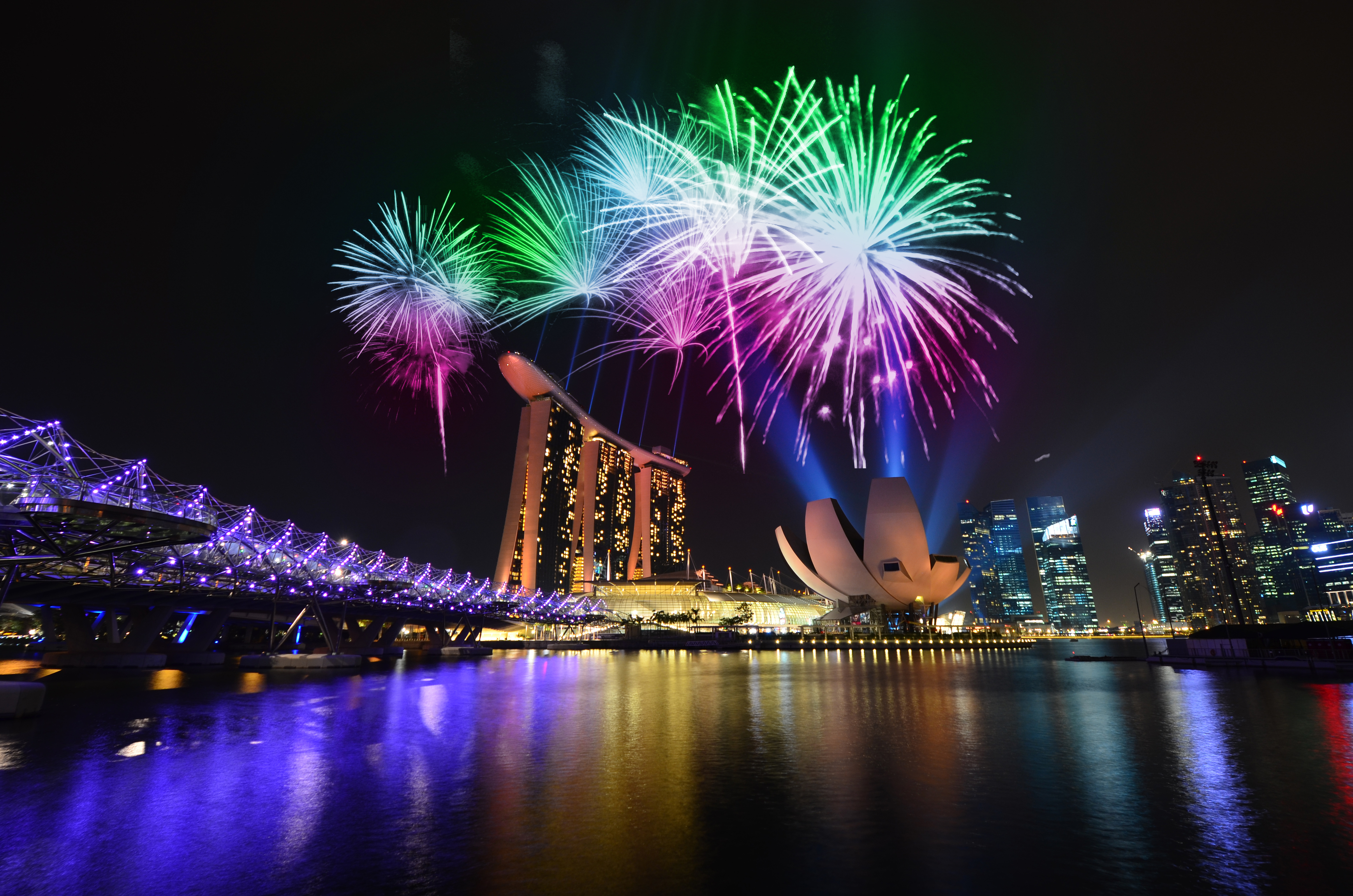 Fireworks over Marina Bay Sands, Hong Kong vs Singapore