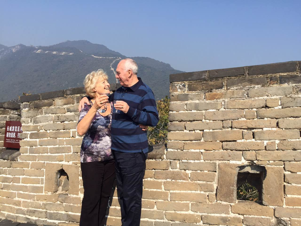 Customers drinking sparkling wine on the Great Wall, Deluxe