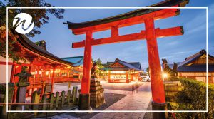 Foxes guard entrance to Fushimi Inari Shrine