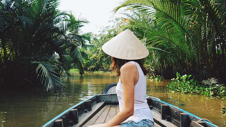 Young tourist rides on a Sampan