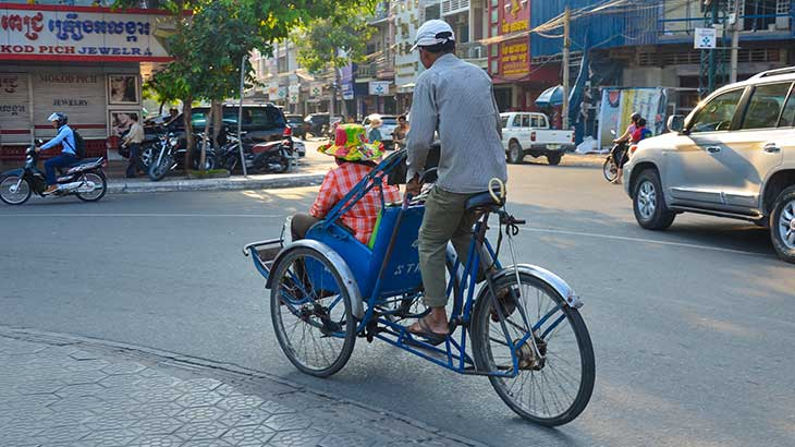 Local man rides tourist in rickshaw