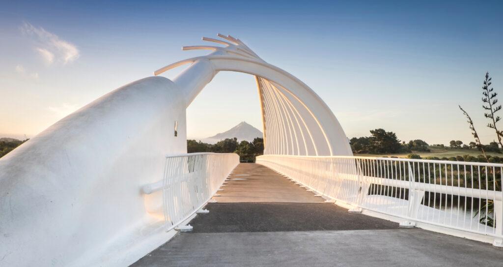 Beautiful white Te Rewa Rewa Bridge with Mt Taranki in the far distance